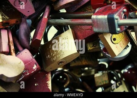 Close Up Of Padlocks On Chain Link Fence - Stock Photo