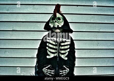 Boy Wearing Skeleton Costume During Halloween - Stock Photo