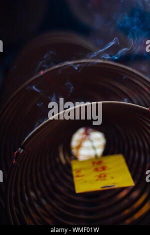 Low Angle View Of Smoke Emitting From Spiral Incense - Stock Photo
