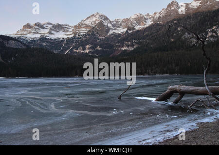 Scenic View Of Snowcapped Mountains By Lake Against Sky - Stock Photo