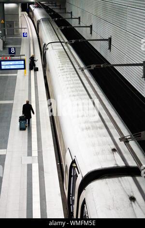 Passengers Standing On Subway Station Platform By Train - Stock Photo