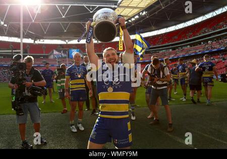 Warrington Wolves Matt Davis celebrates winning the Coral Challenge Cup Final at Wembley Stadium, London. - Stock Photo