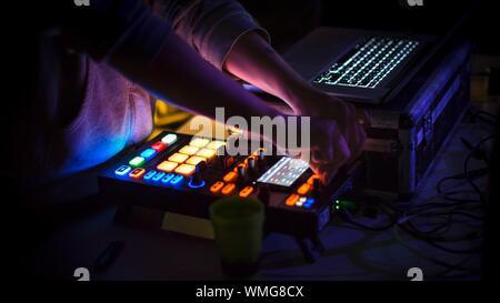 Hands Adjusting Regulators Of A Professional Mixer Unit - Stock Photo