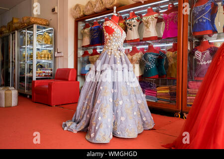 Fancy formal dressing ball gowns for sale at a local shop in Siem Reap, Cambodia. - Stock Photo