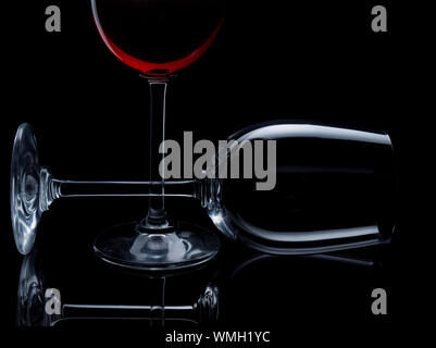 Close-up Of Wine Glasses Against Black Background - Stock Photo