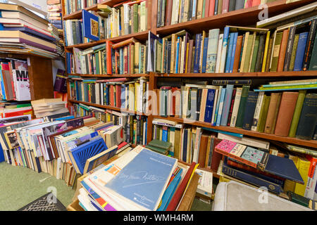 Interior of a very crowded second-hand bookshop. - Stock Photo