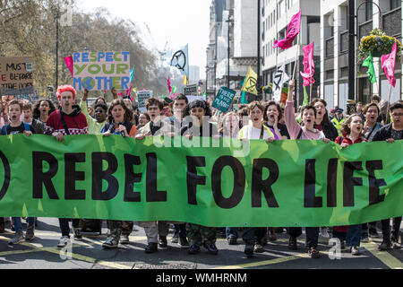Extinction Rebellion protesters gather in Hyde Park Corner continuing the climate protest through Marble Arch congregating in Piccadilly Circus, UK - Stock Photo