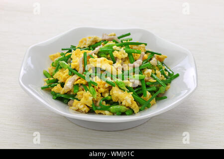 stir fried flowering garlic chives with eggs, chinese cuisine - Stock Photo