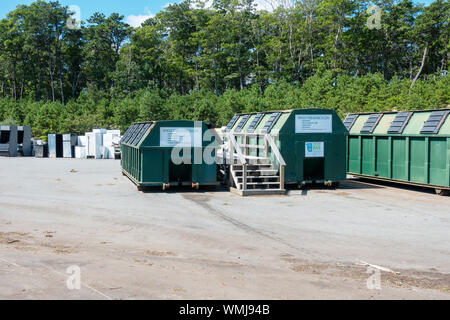 Single stream recycling containers at landfill with appliances incl. refridgerators beyond - Stock Photo