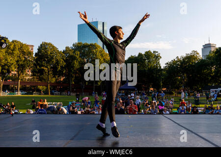 Dancers rehearse before an outdoor summer concert at the Hatch Shell on the Esplanade, Boston Massachusetts USA - Stock Photo