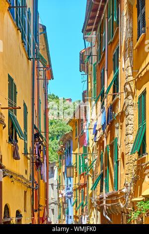 Street with colorful houses in Porto Venere (Portovenere), Liguria, Italy - Stock Photo