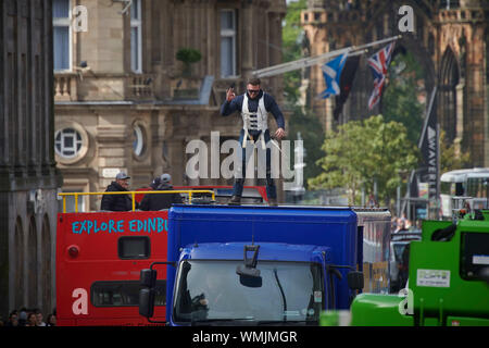 Edinburgh September 05 2019; A stuntman stands on a lorry having jumped from an open top bus during rehearsals for Fast and Furious 9 at Waterloo Place. Credit: Steven Scott Taylor/Alamy Live News - Stock Photo