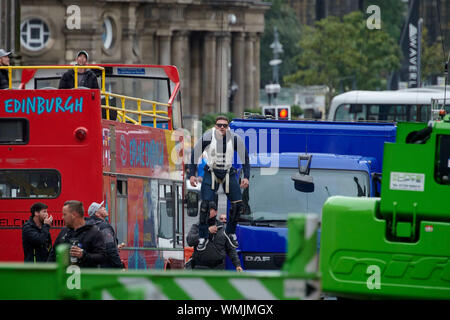 Edinburgh September 05 2019; A stuntman is suspended from a safety wire during rehearsals for Fast and Furious 9 at Waterloo Place. Credit: Steven Scott Taylor/Alamy Live News - Stock Photo