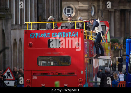 Edinburgh September 05 2019; A stuntman suspended from a safety wire is lifted onto an open top bus during rehearsals for Fast and Furious 9 at Waterloo Place. Credit: Steven Scott Taylor/Alamy Live News - Stock Photo