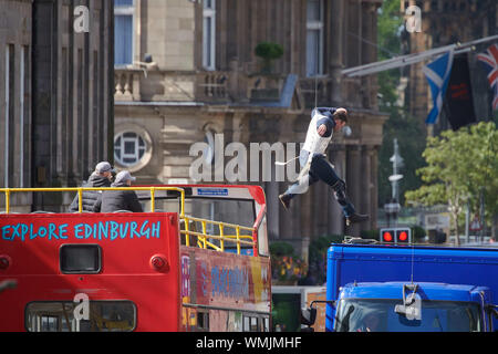 Edinburgh September 05 2019; A stuntman jumps from an open top bus onto a lorry during rehearsals for Fast and Furious 9 at Waterloo Place. Credit: Steven Scott Taylor/Alamy Live News - Stock Photo