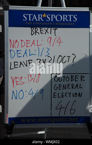 London, UK. 4th September 2019. Brexit betting odds (no-deal, deal, leaving by October 2019 and October General Election, on display at the gates of the Houses of Parliament on Parliament Square. Credit: Joe Kuis / Alamy News - Stock Photo