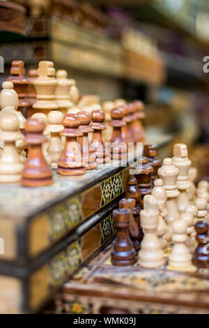 Row Of Chess Pieces On Board At Store For Sale - Stock Photo