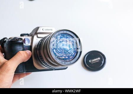 Detail of the Canon 50E analog reflex with the kit lens canon 24-85mm f/3.5-4.5. All shot in a white backround in studio. - Stock Photo