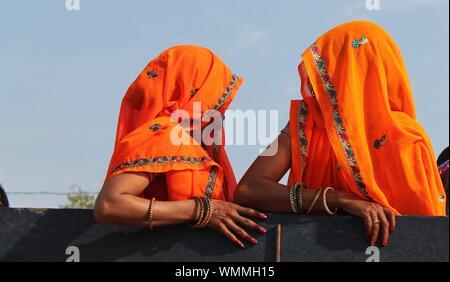 Portrait Of Two Indian Women Wearing Saris - Stock Photo