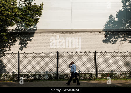MOSCOW, RUSSIA - JULY 18, 2019: Businessman walking down the street - Stock Photo