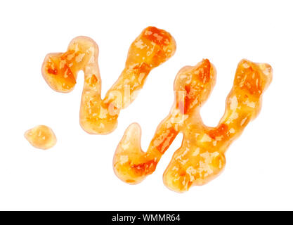Orange thick jam drizzle, isolated on white background. Mandarin marmalade, sauce, topping drops. Top view.