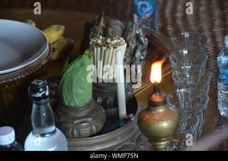 High Angle View Of Diya With Weed On Table - Stock Photo