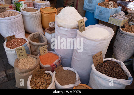 Spices sold in bulk at the spice market in Amman, Jordan. - Stock Photo