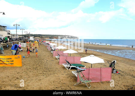 Sandown, Isle of Wight, UK. August 13, 2019. Holidaymakers enjoying the seafront and beach at Sandown on the Isle of Wight, UK. - Stock Photo