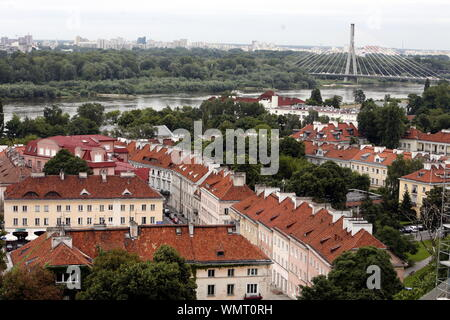 Town With Swietokrzyski Suspension Bridge Over Vistula River Against Sky - Stock Photo