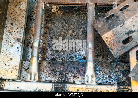 completely dirty grill with fat and rust - Stock Photo