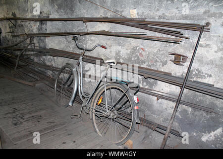 High Angle View Of Old Bicycle Parked Against Weathered Wall - Stock Photo