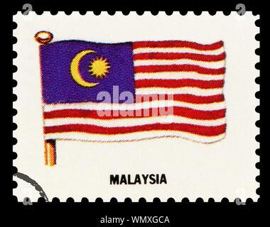 MALAYSIA FLAG - Postage Stamp isolated on black background. - Stock Photo