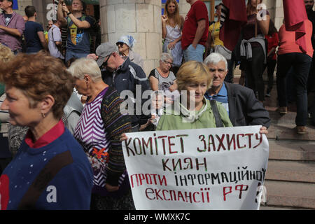 September 5, 2019: Activists hold placards during their protest in front of the National Council of Television and Radio Broadcasting of Ukraine in Kyiv, Ukraine, 05 September 2019. Protesters demand to stop licenses of the News One and 112 Ukrainian TV Channels because they provide anti-Ukrainian politics and are the tool of information expansion of Russia in Ukraine as activists told. Protestors hold placards reading like 'Putin   his supporters = News One', 'No to information attack of the Russia', 'May be enough?' and so on. Credit: Sergii Kharchenko/ZUMA Wire/Alamy Live News - Stock Photo