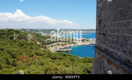 Scenic View Of Green Landscape By Sea Against Sky Seen From Old Building - Stock Photo