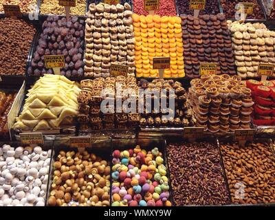 High Angle View Of Various Dried Fruits For Sale At Market Stall - Stock Photo