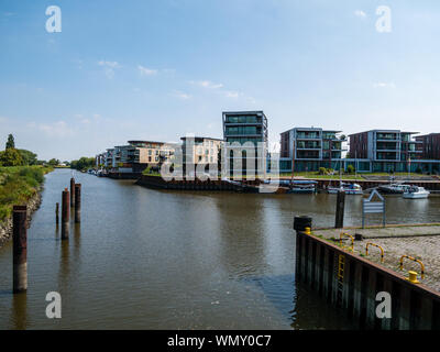 Stade, Germany - August 25, 2019 : View at Hafencity Stade and Schwinge River and anchored traditional sailing boat  named Wilhelmine von Stade at day - Stock Photo