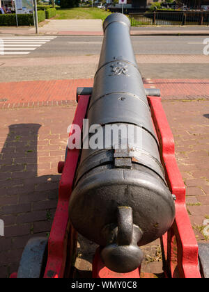 Stade, Germany - August 25, 2019: View at old cannon in front of Swedish Warehouse Museum in historical center of the town of Stade at day. - Stock Photo