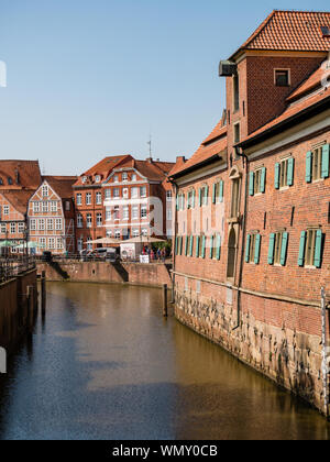 Stade, Germany - August 25, 2019: View at Schwinge River, historical museum at the right and historical center of Stade City. Stade is an interesting - Stock Photo