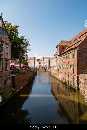 Stade, Germany - August 25, 2019: View at Schwinge River and old historical town of Stade.  Swedish Warehouse Museum at the right. - Stock Photo