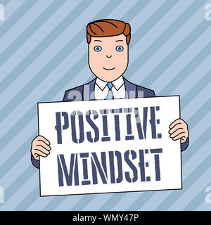 Conceptual hand writing showing Positive Mindset. Concept meaning mental attitude in wich you expect favorable results Smiling Man Holding Suit Poster