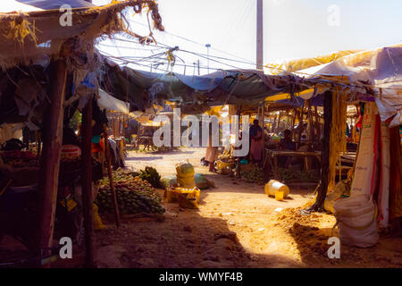 Nanyuki, Laikipia county, Kenya - January 3rd, 2017: Photograph of quiet Kenyan fruit and vegetable market during a typical hot dry day. - Stock Photo