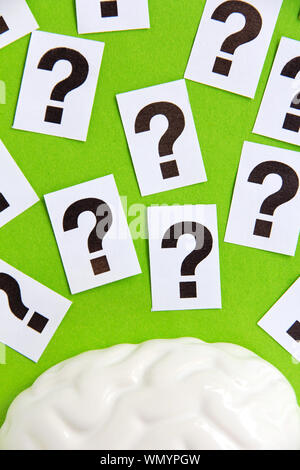 High Angle View Of Food With Question Marks On Green Background - Stock Photo