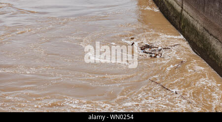 Rhine river with high pollution and mud in a vortex near the electric station - Stock Photo