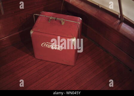 Antique Coca-Cola cooler at the Chesapeake Bay Maritime Museum, St. Michaels, Maryland, United States of America. - Stock Photo