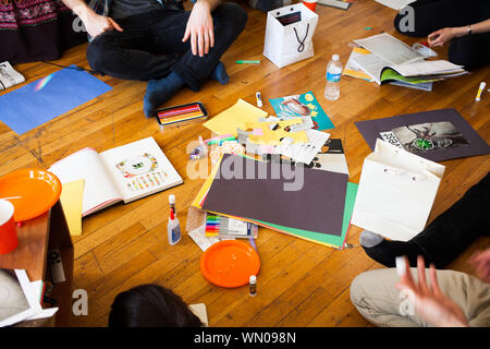 Low Section Of Friends Working On Project At Home - Stock Photo