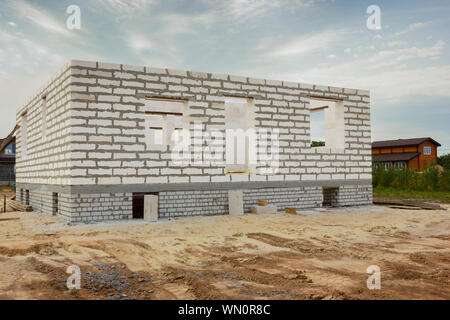 House from foam concrete blocks on the bought site . Beginning of building - Stock Photo