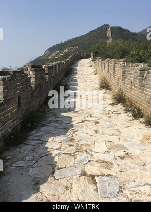 Great Wall Of China Against Clear Sky On Sunny Day - Stock Photo