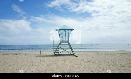 Scenic View Of Lookout Tower On Beach Against Cloudy Sky - Stock Photo