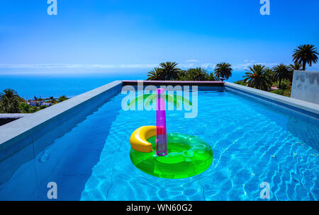 Swimming pool with swimming ring, La Palma, Canary Islands, Spain, Europe. - Stock Photo