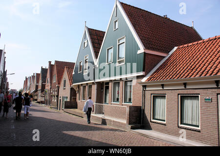 The picturesque fisherman village in Volendam. Typical houses in the fisherman village were mostly built of wood. - Stock Photo